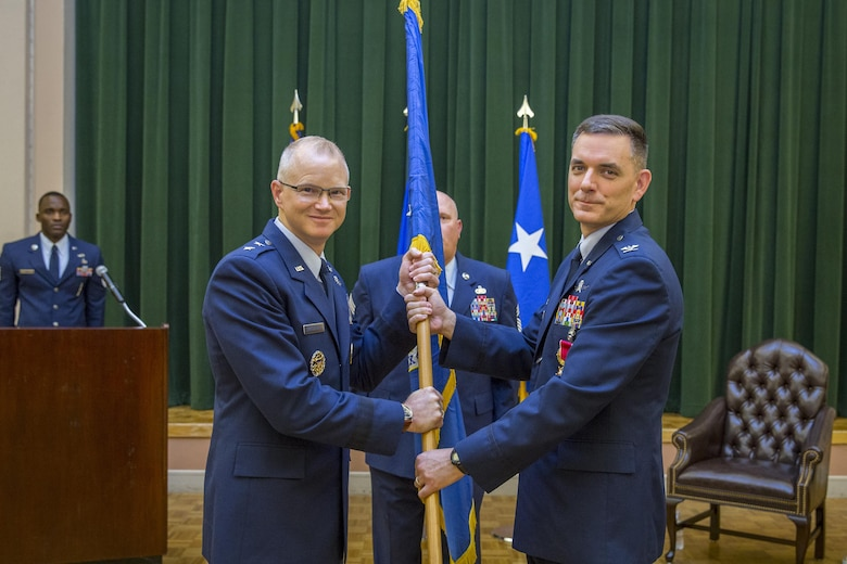 Maj. Gen. Christopher Weggeman, Commander, 24th Air Force, accepts the guidon from Col. David Snoddy, departing 67th Cyberspace Wing commander during the Change of Command ceremony 28 June.