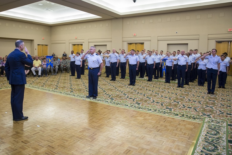 Col Bradley Pyburn, 67th Cyberspace Wing commander, gives his first salute to the command during the 67th CW Change of Command ceremony 28 June.