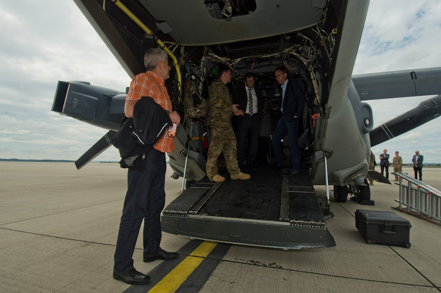 Local German community leaders view a CV-22 Osprey tilt-rotor aircaft assigned to the 352nd Special Operations Wing during a presentation on the flightline near the 726th Air Mobility Squadron at Spangdahlem Air Base, Germany, June 28, 2016. The 352nd SOW, currently stationed at Royal Air Force Mildenhall, United Kingdom, will relocate to Spangdahlem as part of the European Infrastructure Consolidation realignment slated over the coming years. (U.S. Air Force Photo by Staff Sgt. Joe W. McFadden/Released)