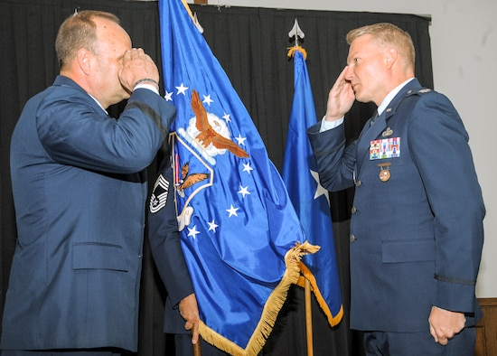 Col. Shan Nuckols, right, 5th Field Investigations Region commander, renders a salute to Brig. Gen. Keith Givens, commander of Air Force Office of Special Investigations, Quantico, Virginia, after assuming command of the 5th FIR June 29, 2016, at Ramstein Air Base, Germany. The 5th FIR supports U.S. Air Forces in Europe and Air Forces Africa commanders across the AFOSI criminal, fraud and counterintelligence mission set. (U.S. Air Force photo/Staff Sgt. Timothy Moore)