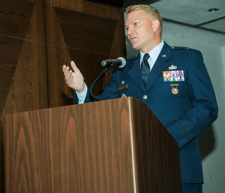 Col. Shan Nuckols gives his first remarks as commander after assuming command of the Air Force Office of Special Investigations' 5th Field Investigations Region June 29, 2016, at Ramstein Air Base, Germany. Nuckols took over of the 5th FIR from Col. James Hudson. (U.S. Air Force photo/Staff Sgt. Timothy Moore)