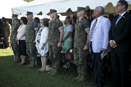 U.S. Marines and guests stand at attention during the 2nd Marine Logistics Group change of command ceremony on Camp Lejeune, N.C., June 8, 2016.  Brig. Gen. Charles G. Chiarotti, outgoing commander, relinquished command to Col. Daniel P. O'Hora. (U.S. Marine Corps photo by Lance Cpl. Samantha A. Barajas)