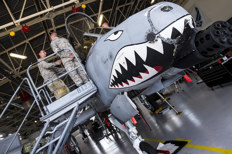 U.S. Air Force Senior Master Sgt. Dillon Johnson, 74th Aircraft Maintenance Unit assistant superintendent, explains the A-10C Thunderbolt II's capabilities and maintenance procedures to Maj. Gen. Scott Zobrist, Ninth Air Force commander, June 28, 2016, at Moody Air Force Base, Ga. During Zobrist's visit, he toured the 23d Maintenance and Fighter Groups and the 347th Rescue Group. (U.S. Air Force photo by Senior Airman Ceaira Young/Released)