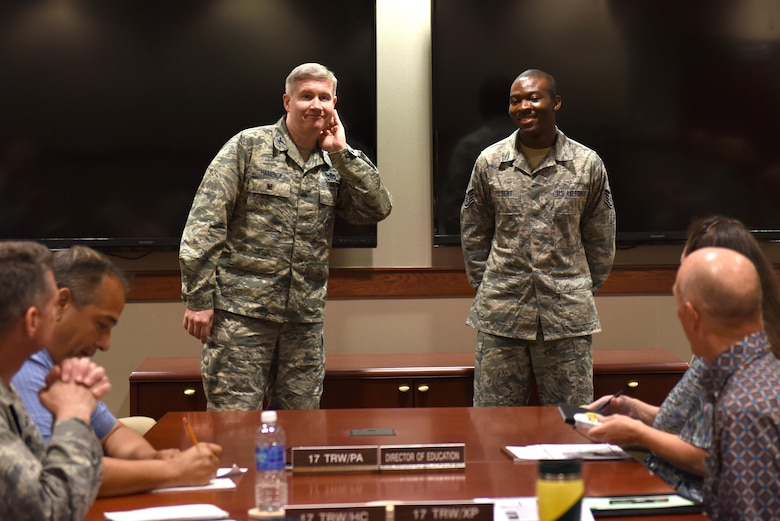 U.S. Air Force Col. Terry Hamrick, 17th Training Wing Vice Commander, gives a shout out to Staff Sgt. Stephen Yelbert, 17th Comptroller Squadron financial services technician and reports and analysis NCO in charge, for his achievements at the Norma Brown Building on Goodfellow Air Force Base, Texas, June 28, 2016. Yelbert received an Air Force 2016 Club Scholarship for $4,000. (U.S. Air Force photo by Airman 1st Class Caelynn Ferguson/Released)
