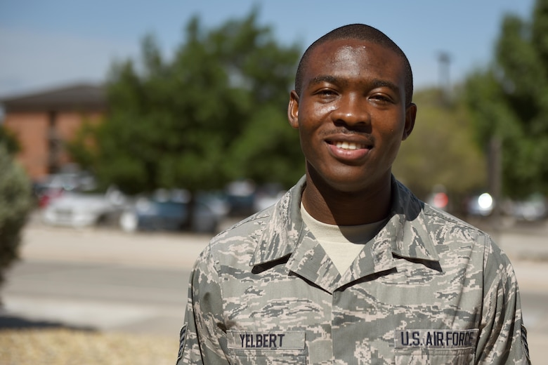 U.S. Air Force Staff Sgt. Stephen Yelbert, 17th Comptroller Squadron financial services technician and reports and analysis NCO in charge, stands outside the Norma Brown Building on Goodfellow Air Force Base, Texas, June 28, 2016. Yelbert received a scholarship for $4,000 and congratulations on his hard work and efforts. (U.S. Air Force photo by Airman 1st Class Caelynn Ferguson/Released)