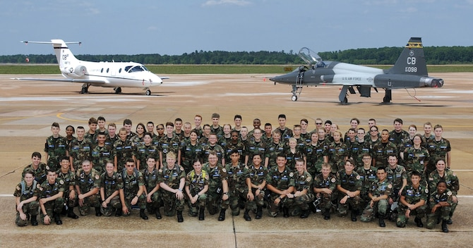 Civil Air Patrol cadets pause on the flightline for a photo with the T-1A Jayhawk and T-38C Talon June 27 Columbus Air Force Base, Mississippi. CAP members toured the base visiting various areas including the Air Traffic Control tower, the enlisted dorms, the aerospace physiology flight, the security forces squadron and the McAllister Fire Station. (U.S. Air Force photo/Sharon Ybarra)