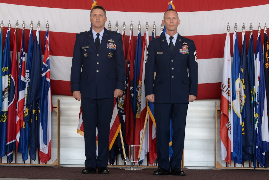 Chief Master Sgt. Geoff Weimer is retired by presiding officer Col. Jason Armagost at Minot Air Force Base, N.D., June 24, 2016. Weimer served as the command chief of the 5th Bomb Wing alongside Armagost from July 2014-June 2016. (U.S. Air Force photo/Airman 1st Class Jessica Weissman)