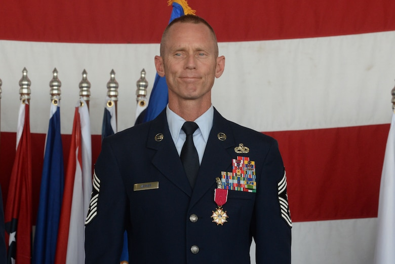Chief Master Sgt. Geoff Weimer smiles as he is officially relieved from active duty at his retirement ceremony at Minot Air Force Base, N.D., June 24, 2016. Weimer served as the command chief of the 5th Bomb Wing since July 2014. (U.S. Air Force photo/Airman 1st Class Jessica Weissman)
