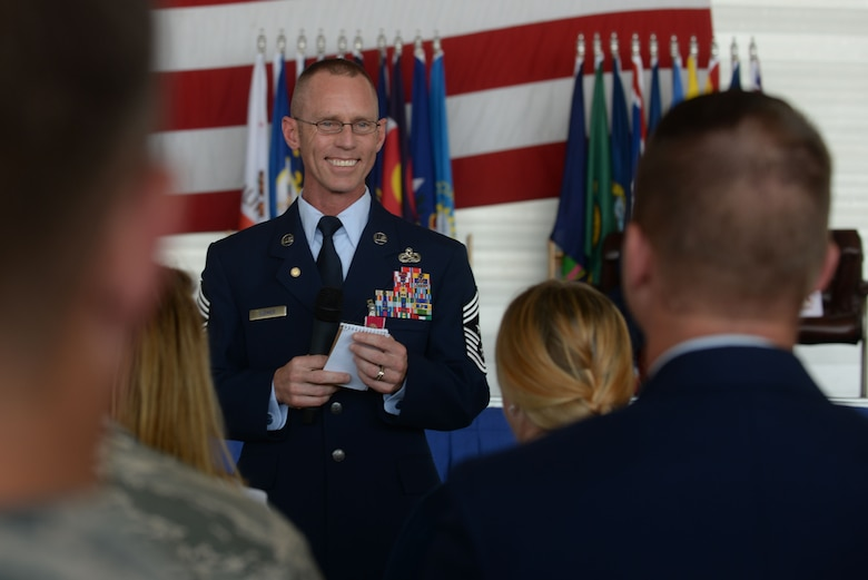 Chief Master Sgt. Geoff Weimer thanks his family for their support at his retirement ceremony at Minot Air Force Base, N.D., June 24, 2016. Weimer served as the command chief of the 5th Bomb Wing for the last two years. (U.S. Air Force photo/Airman 1st Class Jessica Weissman)