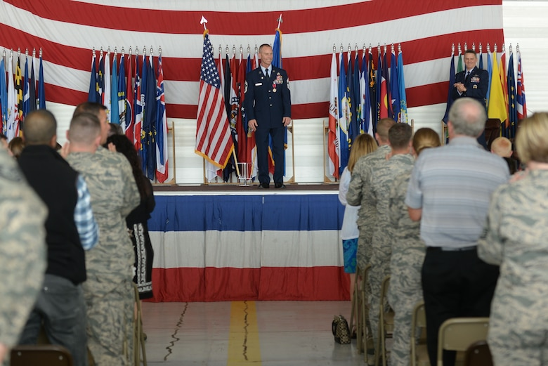 Chief Master Sgt. Geoff Weimer is applauded during his retirement ceremony at Minot Air Force Base, N.D., June 24, 2016. Weimer celebrated his 29 years of service with his final flight of a B-52 Stratofortress June 23. (U.S. Air Force photo/Airman 1st Class Jessica Weissman)