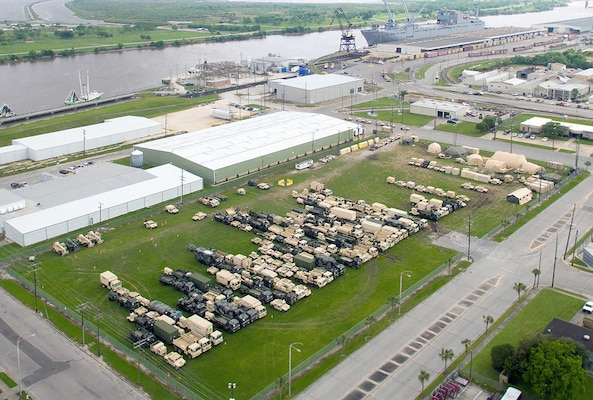 Military vehicles and equipment wait to be loaded from a new seaport facility created by DLA expeditionary logistics teams at Port Arthur, Texas, for Turbo Distribution 16-4 in April 2016.
