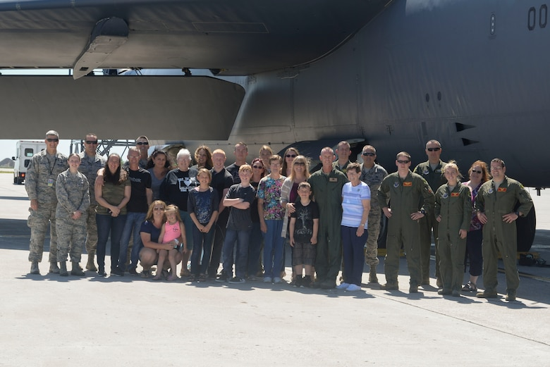 "Chief Master Sgt. Geoff Weimer poses with his family, friends and Airmen from Minot Air Force Base, N.D., after celebration of his ""fini-flight"" June 23, 2016. The ""fini-flight"" is the final flight taken by an aircrew member at his current assignment. (U.S. Air Force photo/Airman 1st Class Jessica Weissman)"