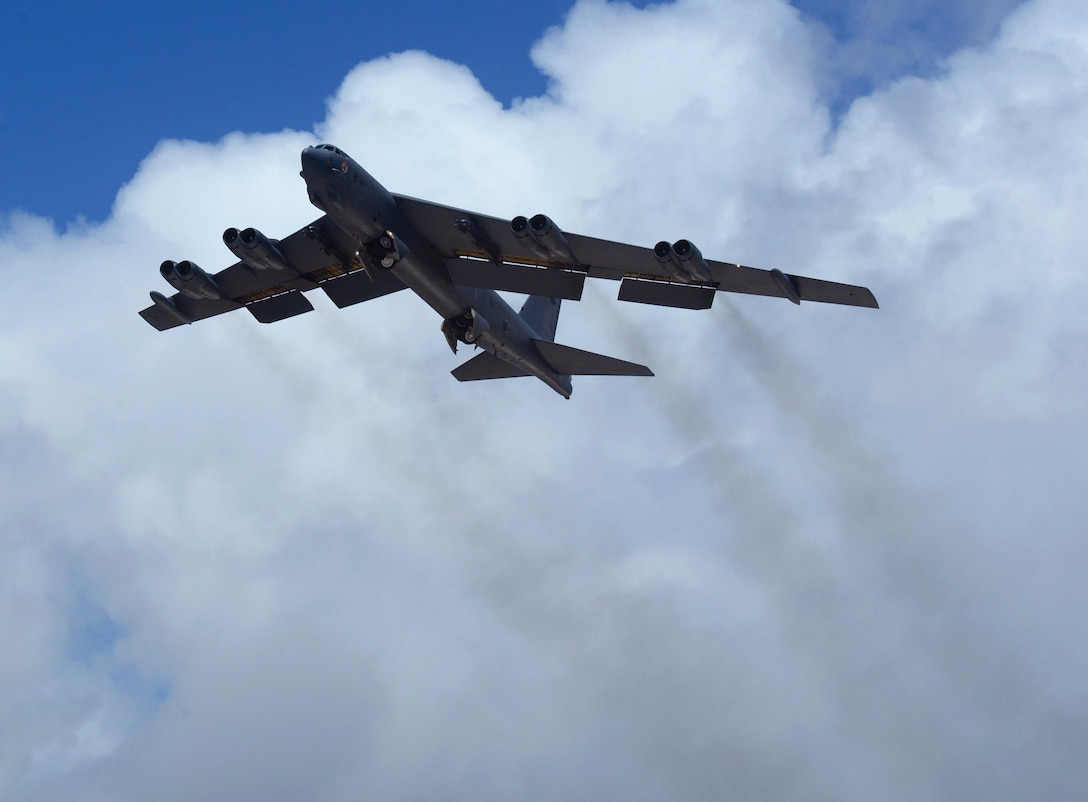 A B-52 Stratofortress from Minot Air Force Base, N.D., takes flight June 16, 2016, at Andersen Air Force Base, Guam. The aircraft is deployed in support of U.S. Pacific Command's continuous bomber presence operations. These aircraft and the men and women who fly and support them provide a significant capability that enables U.S. readiness and commitment to deterrence, provides assurances to allies, and strengthens regional security and stability in the Indo-Asia-Pacific region. (U.S. Air Force photo/Airman 1st Class Alexa Ann Henderson)