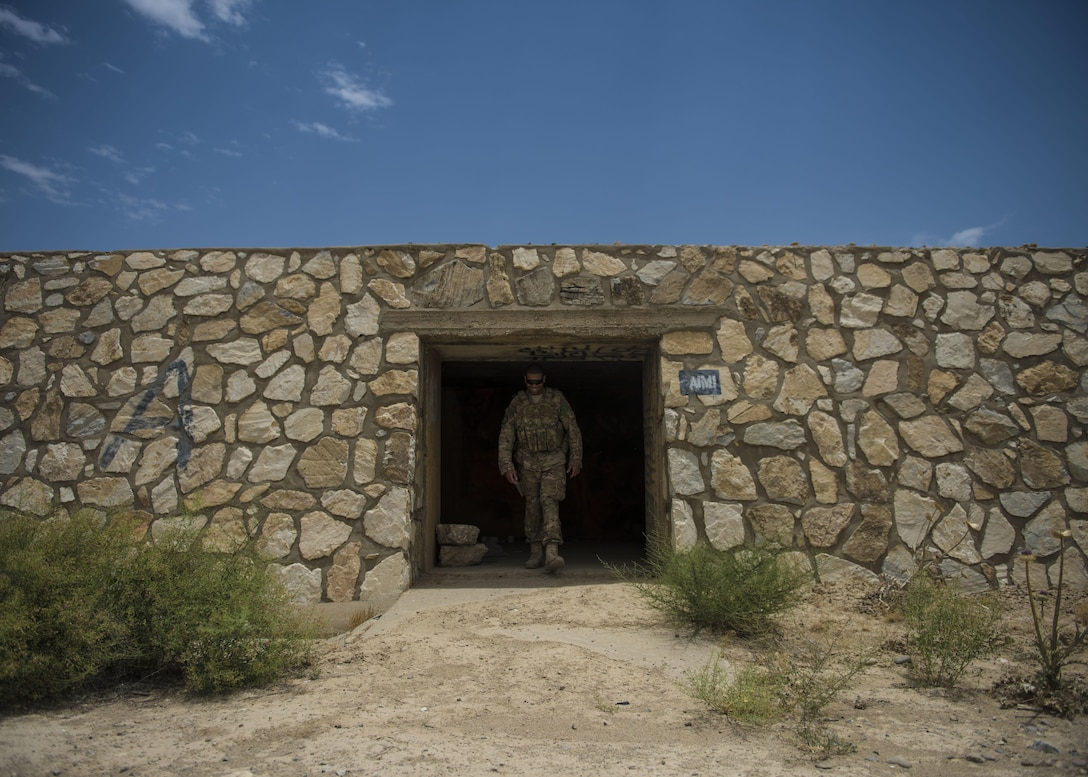 Staff Sgt. Gary Allsbrook, a 455th Expeditionary Security Forces Squadron quick reaction force member, walks out of an old bunker June 27, 2016, at Bagram Airfield, Afghanistan. The squadron's QRF teams check buildings and other areas on the flightline in order to deter threats. (U.S. Air Force photo/Senior Airman Justyn M. Freeman)