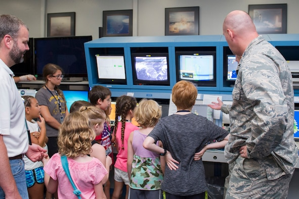 Members of the 45th Weather Squadron demonstrate how the weatherbot works during a Young Minds at Work session June 30, 2016, at Cape Canaveral Air Force Station, Fla. Children toured the Morrell Operations Center and learned about how the Air Force supports the unique operation for each rocket launch mission. Airmen teamed up with Lockheed Martin to showcase Air Force capabilities to encourage children to get interested in the study of Science, Technology, Engineering, and Math (STEM).