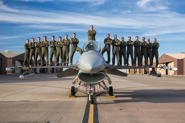 Class 15-BBH, the inaugural class from the 314th Fighter Squadron, stands on top of an F-16 Fighting Falcon at Holloman Air Force Base, N.M. Over 60 percent of the 17-man class will be going overseas following their June 25th graduation. (Courtesy Photo)