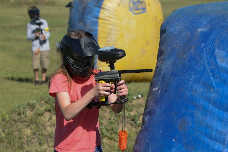 Natalie Drain, a member of the youth center at Minot Air Force Base, N.D., shoots a paintball gun during Paintball 101 June 17, 2016. Children learned the basic skills from skilled professionals and participated in a week-long camp offered to members of the youth center. (U.S. Air Force photo/Airman 1st Class Jessica Weissman)