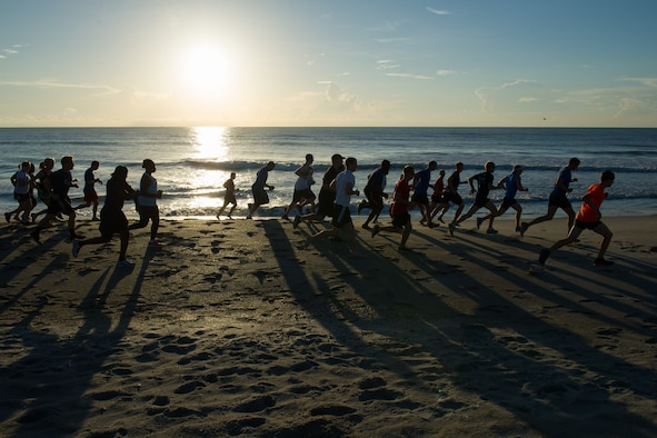 Members of the 45th Space Wing compete in a three mile run to celebrate America's 240th birthday June 30, 2016, at the Beach House Patrick Air Force Base, Fla. The 45th Force Support Squadron hosted the Independence Day Beach Run, including a sandbag circuit of repetitions, one for each year since the birth of the country. (U.S. Air Force photos/Benjamin Thacker/Released)