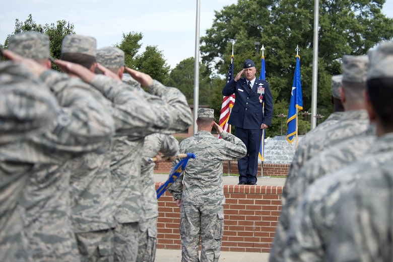Col. Mark Slocum, outgoing 4th Fighter Wing commander, renders his final salute to Airmen of the 4th Fighter Wing during a change of command ceremony, June 30, 2016, at Seymour Johnson Air Force Base, North Carolina. Slocum relinquished command to Col. Christopher Sage, who has served at Seymour Johnson AFB on two previous assignments. (U.S. Air Force photo/Tech. Sgt. Chuck Broadway)