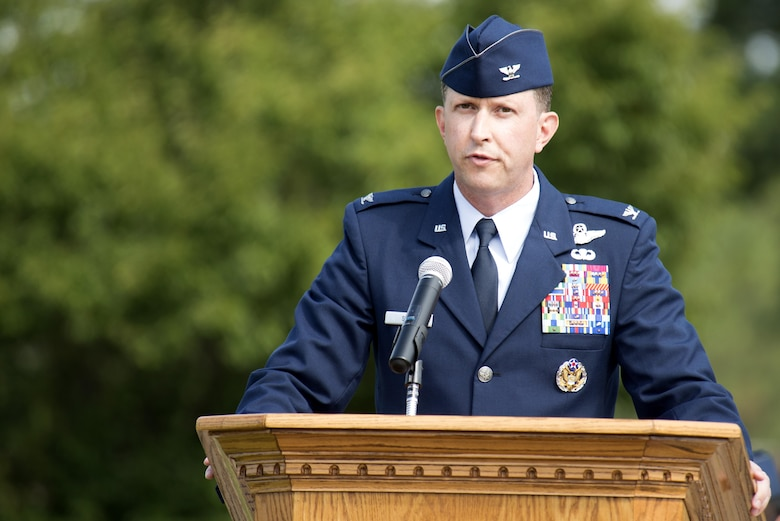 Col. Christopher Sage, 4th Fighter Wing commander, speaks to Airmen after assuming command of the 4th Fighter Wing, June 30, 2014, at Seymour Johnson Air Force Base, North Carolina. Sage has supported Operations NORTHERN WATCH, DELIBERATE FORGE, ALLIED FORCE, ENDURING FREEDOM and IRAQI FREEDOM and has logged more than 4,100 flight hours during his 22-year career. (U.S. Air Force photo/Tech. Sgt. Chuck Broadway)