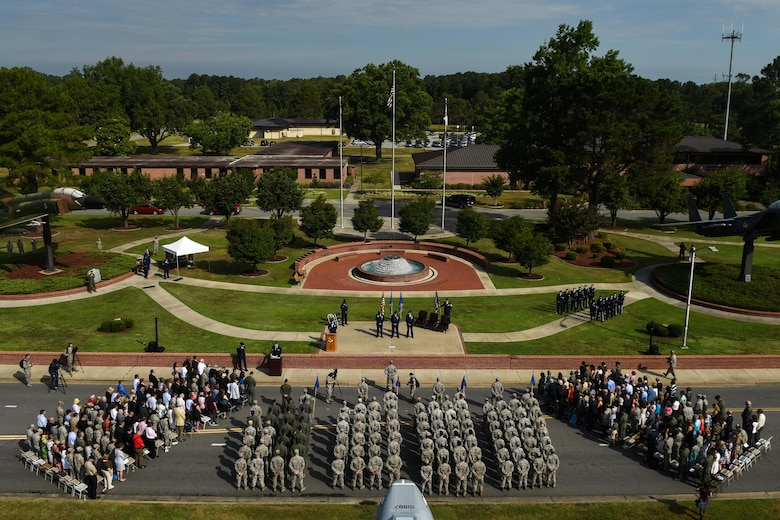 Airmen of the 4th Fighter Wing stand in formation during a change of command ceremony, June 30, 2016, at Seymour Johnson Air Force Base, North Carolina. Col. Christopher Sage, the former senior military assistant to the deputy chairman of the NATO Military Committee in Brussels, Belgium, assumed command from Col. Mark Slocum during the ceremony. (U.S. Air Force photo by Airman Shawna L. Keyes/Released)