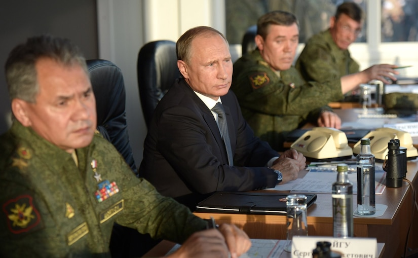 Russian President Vladimir Putin and some of his top military brass, including Defense Minister Sergey Shoygu (left)