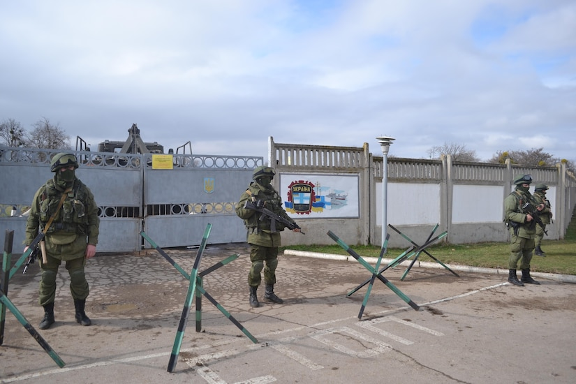 "Known as the ""little green men,"" Russian soldiers stand watch over Perevalne military base in Crimea. (March 2014)"