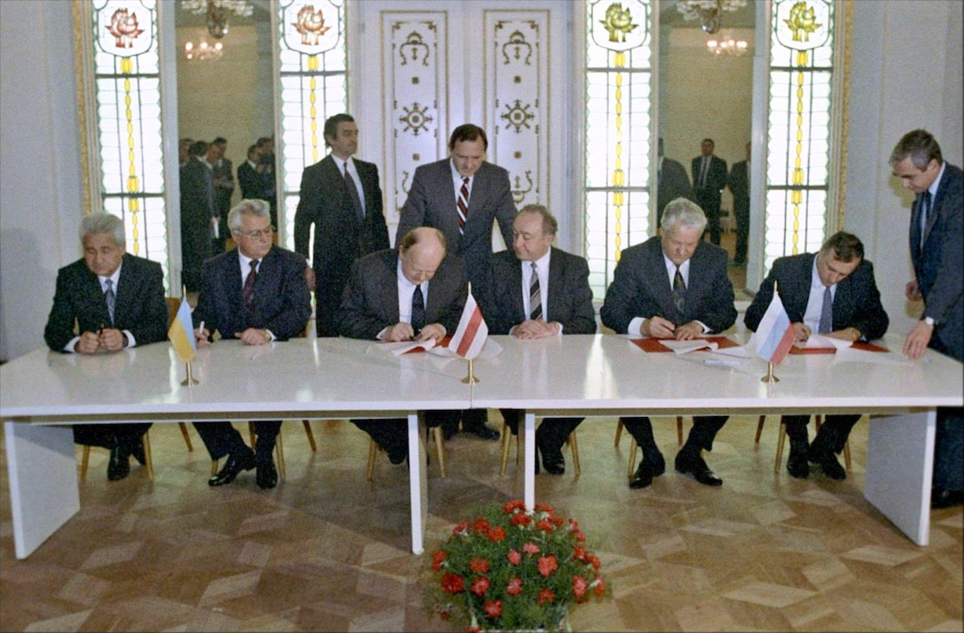 Leaders from Russia, Belarus, and the Ukraine gathered to sign the documents dissolving the Soviet Union and creating the Commonwealth of Independent States on December 8, 1991.