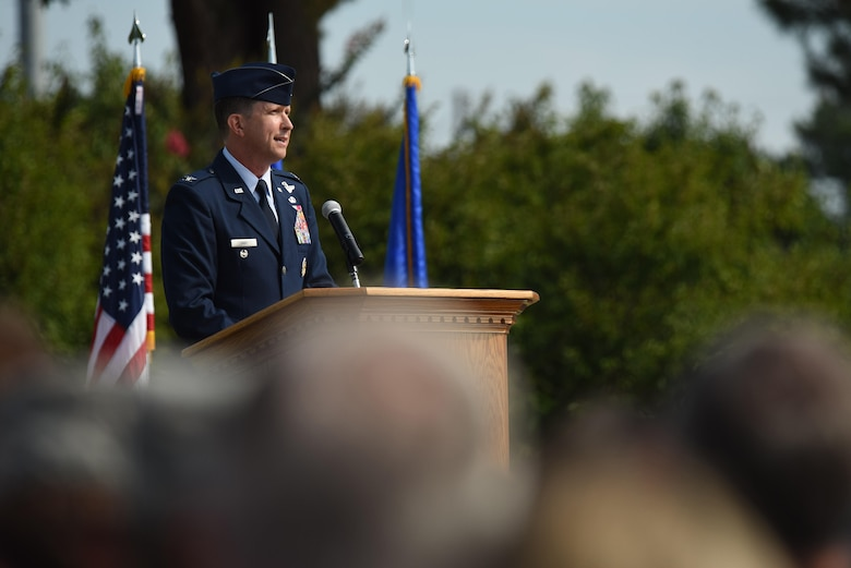 Col. Christopher Sage, 4th Fighter Wing commander, speaks to Airmen after assuming command of the 4th Fighter Wing, June 30, 2014, at Seymour Johnson Air Force Base, North Carolina. Sage has supported operations NORTHERN WATCH, DELIBERATE FORGE, ALLIED FORCE, ENDURING FREEDOM and IRAQI FREEDOM and has logged more than 4,100 flight hours during his 22-year career. (U.S. Air Force photo by Senior Airman Brittain Crolley)