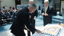 Brig. Gen. Christopher J. Mahoney, left, and Bill A. Miller cut a cake during the Diplomatic Security Service Centennial ceremony at the National Museum of the Marine Corps in Triangle, Virginia, June 29, 2016. The ceremony also celebrated the 70th Anniversary of the Marine Corps Embassy Security Group, which has been working alongside the DSS since 1946. Miller is the director of DSS and Mahoney is the director of Strategy and Plans Division, Plans, Policies and Operations, Headquarters Marine Corps.