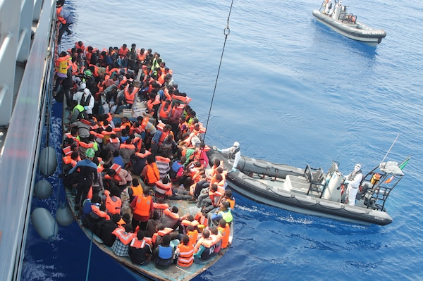 Irish Naval personnel from the LE Eithne rescuing migrants as part of Operation Triton.