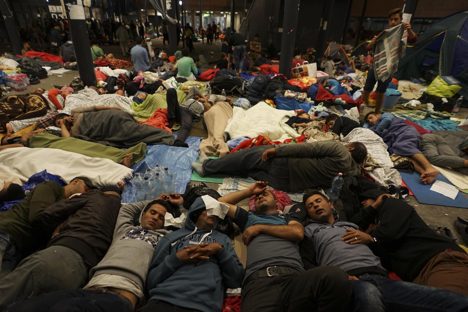 Syrian refugees having rest at the floor of Keleti railway station. Refugee crisis. Budapest, Hungary, Central Europe, 5 September 2015.