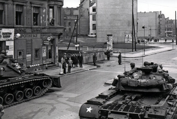 Soldiers from the U.S. Army Berlin Command face off against police from the former East Germany during one of several standoffs at Checkpoint Charlie in 1961. On several occasions that year, a U.S. quick reaction force of tanks and infantry Soldiers stood watch as armed military policemen escorted U.S. personnel across the border into East Berlin. (U.S. Army photo)