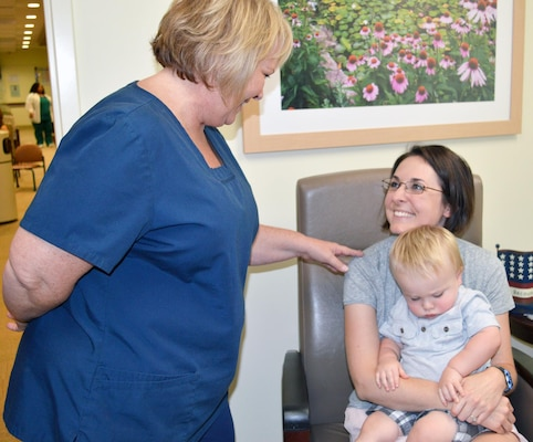 Lactation consultant Carolyn Lowe (left) talks with Bridget Owens about breastfeeding her baby, 16-month-old James Owens, during an appointment June 24 at Brooke Army Medical Center.