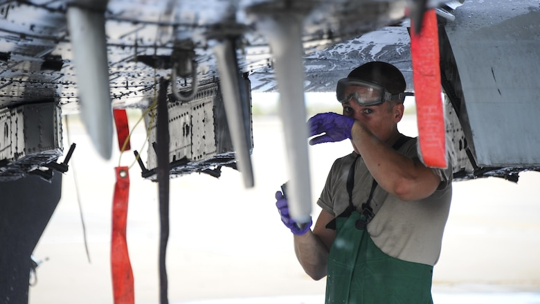 U.S. Air Force Airman 1st Class Ryan Meilleur, 354th Aircraft Maintenance Unit crew chief, wipes his face while cleaning an A-10C Thunderbolt II on the flightline of Davis-Monthan Air Force Base, Ariz., June 29, 2016. The 354th AMU's parent unit, 355th Aircraft Maintenance Squadron, generates all combat and training sorties in the 355th Fighter Wing and manages the efforts of 571 personnel in 13 different specialties of maintaining A-10 attack aircraft. (U.S. Air Force photo by Airman 1st Class Mya M. Crosby/Released)