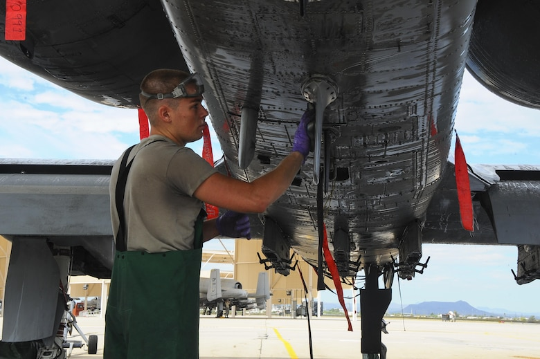 U.S. Air Force Airman 1st Class Ryan Meilleur, 354th Aircraft Maintenance Unit crew chief, washes an A-10C Thunderbolt II on the flightline of Davis-Monthan Air Force Base, Ariz., June 29, 2016. The squadron provides safe, properly configured aircraft in order to meet the flying hour program for three squadrons. (U.S. Air Force photo by Airman 1st Class Mya M. Crosby/Released)