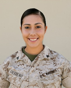 Cpl. Crystal M. Guerrero, small arms repair technician, Headquarters Battalion, developed her love of weapons and desire to work in the armory from her father who was a Marine and taught her. (Official Marine Corps photo by Lance Cpl. Dave Flores/Released)