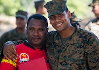 U.S. Marine Cpl. Joseph Osorio with Task Force Koa Moana poses for a picture with Papua New Guinea soldier before departing their separate ways concluding Exercise Koa Moana, Taurama Barracks, Papua New Guinea, June 23, 2016. Throughout the deployment the Marines and Sailors with the task force shared infantry, law enforcement and engineering skills with Papua New Guinea to strengthen relationships and interoperability in the Asia-Pacific region. (U.S. Marine Corps imagery by MCIPAC Combat Camera Lance Cpl. Jesus McCloud/ Released)