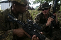 Lance Cpl. Jake E. Gieseke (Right) teaches Pvt. Sezio Nono (Right) different firing positions, June 21, 2016, during Exercise Koa Moana, at Goldie Barracks, Papua New Guinea, as part of Task Force Koa Moana's deployment in the Asia-Pacific region. Koa Moana is the first multi-national, bilateral exercise between the Papua New Guinea Defence Force and U.S. Marines directly, and is designed to increase interoperability and relations by sharing infantry, law enforcement, engineering and medical skills. Gieseke, from New Ulm, Minnesota, is an assault man with Task Force Koa Moana, originally assigned to Alpha Company, 1st Battalion, 1st Marine Regiment, 1st Marine Division, I Marine Expeditionary Force. Nono is an infantryman with Charlie Company, 1st Battalion, 1st Royal Pacific Islands Regiment, PNGDF. (U.S. Marine Corps photo by Cpl. William Hester/ Released)