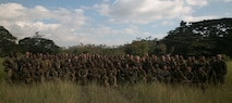 U.S. Marines and Sailors and soldiers with the Papua New Guinea Defence Force gather for a group photo after conducting live fire training, June 21, 2016, during Exercise Koa Moana, at Goldie Barracks, Papua New Guinea, as part of Task Force Koa Moana's deployment in the Asia-Pacific region. Koa Moana is the first multi-national, bilateral exercise between the PNGDF and U.S. Marines directly, and is designed to increase interoperability and relations by sharing infantry, medical, engineering and law enforcement skills. The Marines and Sailors with Task Force Koa Moana are originally assigned to I and III Marine Expeditionary Force. The soldiers are with 1st Battalion, 1st Royal Pacific Islands Regiment, PNGDF. (U.S. Marine Corps photo by Cpl. William Hester/ Released)
