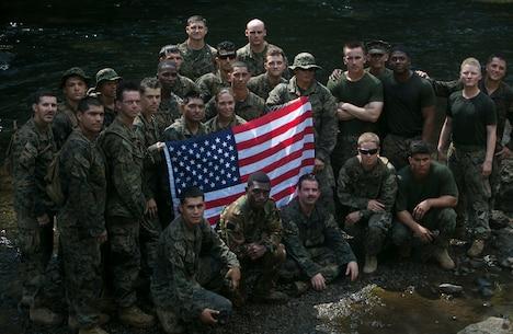 U.S. Marines, Sailors and Soldiers with the Papua New Guinea Defence Force gather at the Goldie River for a group photo, June 22, 2016, during their hike on the Kokoda Trail, Papua New Guinea in remembrance of the battles fought there during WWII, as part of Exercise Koa Moana. Koa Moana is the first multi-national, bilateral exercise between the PNGDF and U.S. Marines directly, and is designed to increase interoperability and relations by sharing infantry, engineering, medical and law enforcement skills. The Marines and Sailors with Task Force Koa Moana are originally assigned to I and III Marine Expeditionary Force. The Soldiers are with 1st Battalion, 1st Royal Pacific Islands Regiment, PNGDF. (U.S. Marine Corps photo by Cpl. William Hester/ Released)