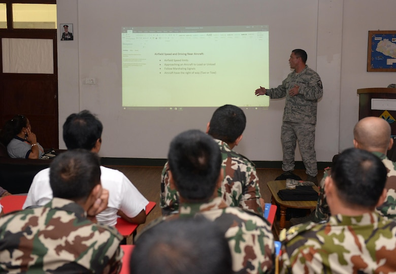 Master Sgt. Clint Hutchinson, 36th Contingency Response Group, briefs U.S. Airmen and Nepalese service members on airfield driving procedures during a subject-matter expert exchange on cargo handling June 28, 2016, at Tribhuvan International Airport in Kathmandu, Nepal. Ten Airmen from the 36th CRG and more than 20 participants from various Nepalese organizations exchanged knowledge on all elements of cargo handling. (U.S. Air Force photo by Staff Sgt. Benjamin Gonsier/Released)