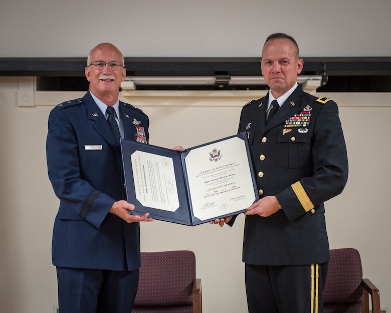 Maj. Gen. Mark R. Kraus (left), Air National Guard assistant to the commander, United States Air Forces Central Command, is presented with his Certificate of Retirement by Brig. Gen. Stephen R. Hogan, Kentucky's adjutant general, during Kraus' retirement ceremony at the Kentucky Air National Guard Base in Louisville, Ky., June 12, 2016.  Kraus served for more than 43 years in the United States Air Force and Air National Guard. (U.S. Air National Guard photo by Master Sgt. Phil Speck)