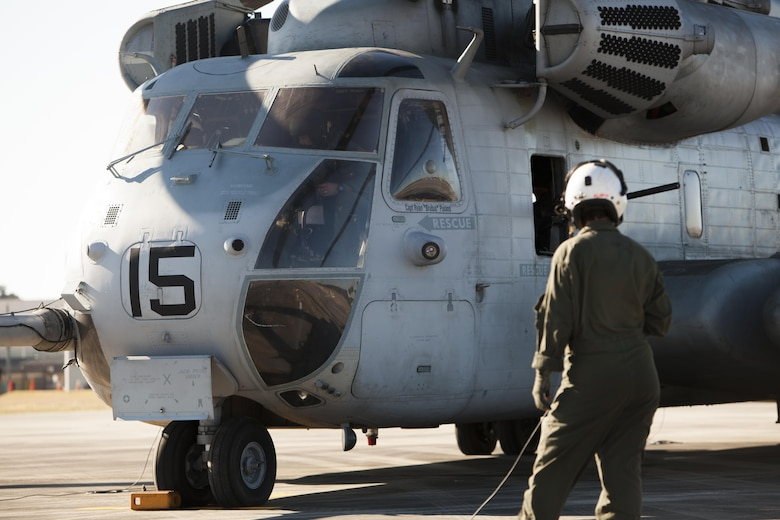 Lance Cpl. Samantha Alaw inspects a CH-53E Super Stallion before flight during Exercise Eager Response at Marine Corps Air Station Beaufort, S.C., Feb. 25, 2016. During the exercise, Marines trained in events such as casualty evacuation, assault support missions and aerial refueling, proving the Marine Air-Ground Task Force is a highly effective combat force. Alaw is a CH-53E crew chief with Marine Heavy Helicopter Squadron 366. (U.S. Marine Corps photo by Pfc. Nicholas P. Baird/Released)
