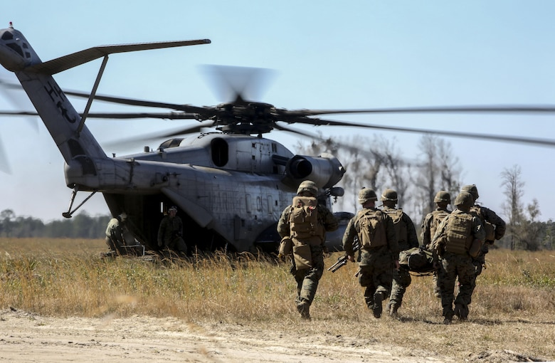 Marines with India Company, 3rd Battalion, 6th Marine Regiment, conduct a simulated casualty evacuation as part of exercise Eager Response at Fort Stewart, Ga., Feb. 26, 2016. The battalion conducted the training with the support of a CH-53E Super Stallion operated by Marines with Marine Heavy Helicopter Squadron 366. During Exercise Eager Response, Marines trained in events such as casualty evacuation, assault support missions and aerial refueling, proving the Marine Air-Ground Task Force is a highly effective combat force. (U.S. Marine Corps photo by Cpl. Paul S. Martinez/Released)