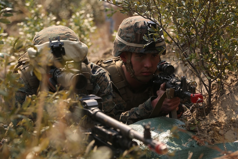 Marines with 3rd Battalion, 6th Marine Regiment, secure defensive positions as part of exercise Eager Response at Fort Stewart, Ga., Feb. 26, 2016. Throughout the exercise, a platoon-sized opposing force sporadically attacked the battalion day and night, challenging their ability to fortify and defend positions. (U.S. Marine Corps photo by Cpl. Paul S. Martinez/Released)