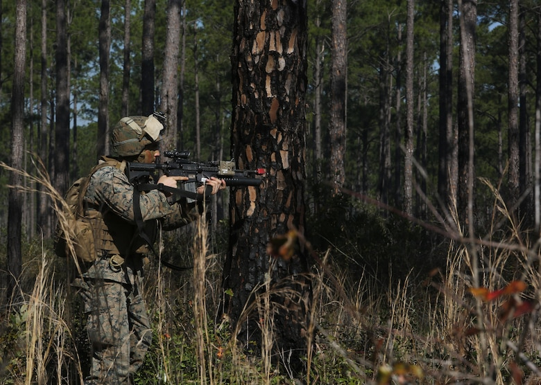 Lance Cpl. Allan C. Lammon, a team leader with India Company, 3rd Battalion, 6th Marine Regiment, defends against an opposing force as part of exercise Eager Response at Fort Stewart, Ga., Feb. 26, 2016. Throughout the exercise, a platoon-sized opposing force sporadically attacked the battalion day and night, challenging their ability to fortify and defend positions.  (U.S. Marine Corps photo by Cpl. Paul S. Martinez/Released)