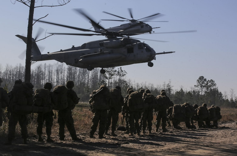 Marines with 3rd Battalion, 6th Marine Regiment, prepare to board CH-53E Super Stallions at the conclusion of exercise Eager Response at Fort Stewart, Ga., Feb. 28, 2016. The battalion was inserted and extracted via MV-22 Ospreys and CH-53E Super Stallions assigned to the 2nd Marine Aircraft Wing. (U.S. Marine Corps photo by Cpl. Paul S. Martinez/Released)