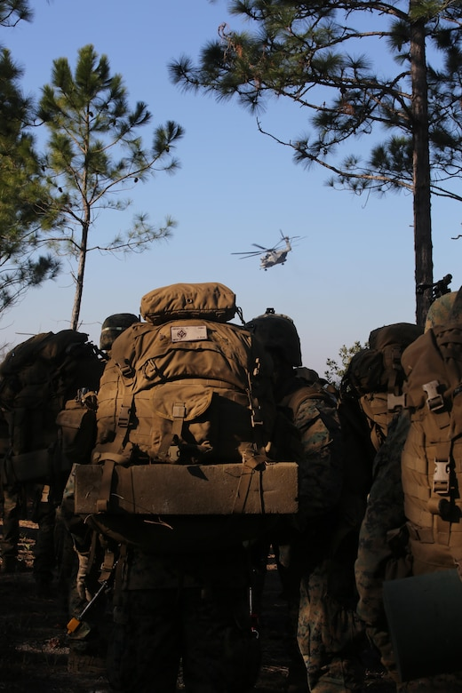 Marines with 3rd Battalion, 6th Marine Regiment, prepare to board CH-53E Super Stallion helicopters at the conclusion of exercise Eager Response at Fort Stewart, Ga., Feb. 28, 2016. The battalion was inserted and extracted via MV-22 Ospreys and CH-53E Super Stallions assigned to the 2nd Marine Aircraft Wing. (U.S. Marine Corps photo by Cpl. Paul S. Martinez/Released)