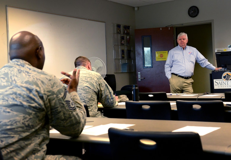 A U.S. Airman asks retired U.S. Army Maj. Rick Wise, Troops to Teachers South Carolina program manager, a question at the Troops to Teachers seminar at Shaw Air Force Base, S.C., Feb. 17, 2016. The Troops to Teachers program assists military members and their families who are transitioning into teaching careers. (U.S. Air Force photo by Airman 1st Class Destinee Dougherty)